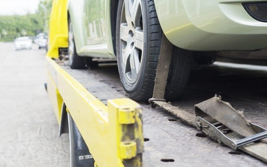 car-transporter-breakdown-lorry-during-working-using-locked-belt-transport-other-green-car